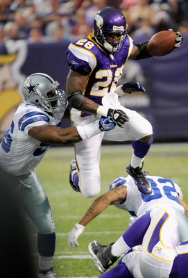 MINNEAPOLIS, MN - AUGUST 27: Mike Balogun #55 of the Dallas Cowboys attempts a tackle of Adrian Peterson #28 of the Minnesota Vikings in the first half on August 27, 2011 at Hubert H. Humphrey Metrodome in Minneapolis, Minnesota. (Photo by Hannah Foslien/