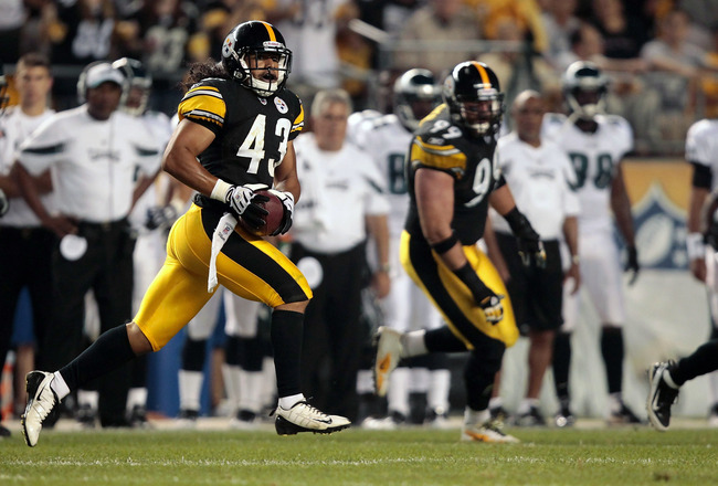 PITTSBURGH - AUGUST 18:  Troy Polamalu #43 of the Pittsburgh Steelers runs with an intercepted pass against the Philadelphia Eagles during the preseason game on August 18, 2011 at Heinz Field in Pittsburgh, Pennsylvania.  (Photo by Jared Wickerham/Getty I