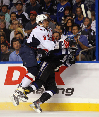 TAMPA, FL - MAY 04:  Alex Ovechkin #8 of the Washington Capitals hits Blair Jones #49 of the Tampa Bay Lightning into the boards in Game Four of the Eastern Conference Semifinals during the 2011 NHL Stanley Cup Playoffs at the St Pete Times Forum on May 4