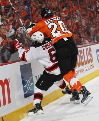 PHILADELPHIA - APRIL 18: Andy Greene #6 of the New Jersey Devils is hit into the boards by Chris Pronger #20 of the Philadelphia Flyers in Game Three of the Eastern Conference Quarterfinals during the 2010 NHL Stanley Cup Playoffs at the Wachovia Center o