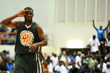 BALTIMORE, MD - AUGUST 30: Chris Paul salutes to the crowd during the Goodman League All-Stars taking on The Melo League basketball game at Edward P. Hurt Gymnasium at Morgan State University on August 30, 2011 in Baltimore, Maryland. (Photo by Patrick Sm