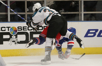 NEW YORK - OCTOBER 19: Douglas Murray #3 of the San Jose Sharks hits Sean Avery #16 of the New York Rangers at Madison Square Garden on October 19, 2009 in New York, New York. (Photo by Bruce Bennett/Getty Images)