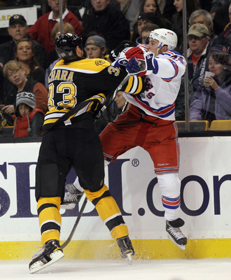 BOSTON - OCTOBER 23: Ryan Callahan #24 of the New York Rangers is hit by Zdeno Chara #33 of the Boston Bruins at the TD Garden on October 23, 2010 in Boston, Massachusetts.  (Photo by Bruce Bennett/Getty Images)