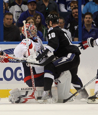 TAMPA, FL - MAY 03: Adam Hall #18 of the Tampa Bay Lightning stops short of hitting Michal Neuvirth #30 of the Washington Capitals  in Game Three of the Eastern Conference Semifinals during the 2011 NHL Stanley Cup Playoffs at St Pete Times Forum on May 3