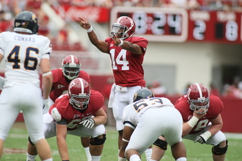 TUSCALOOSA, AL - SEPTEMBER 3:  Quarterback Phillip Sims #14 of the Alabama Crimson Tide calls out coverage's during the game with the Kent State Golden Flashes on September 3, 2011 at Bryant Denny Stadium in Tuscaloosa, Alabama.  Alabama defeated Kent Sta