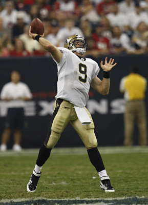 HOUSTON - AUGUST 20:  Quarterback Drew Brees #9 of the New Orleans Saints throws downfield against the Houston Texans at Reliant Stadium on August 20, 2011 in Houston, Texas.  (Photo by Bob Levey/Getty Images)