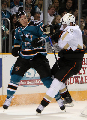 SAN JOSE, CA - APRIL 19:  Corey Perry #10 of the Anaheim Ducks hits Christian Ehrhoff #10 of the San Jose Sharks during Game Two of the Western Conference Quarterfinals of the 2009 Stanley Cup Playoffs on April 19, 2009 at HP Pavilion in San Jose, Califor