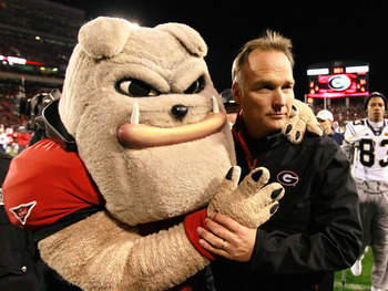 ATHENS, GA - NOVEMBER 27:  Head coach Mark Richt and Hairy, mascot of the Georgia Bulldogs, celebrate their 42-34 win over the Georgia Tech Yellow Jackets at Sanford Stadium on November 27, 2010 in Athens, Georgia.  (Photo by Kevin C. Cox/Getty Images)
