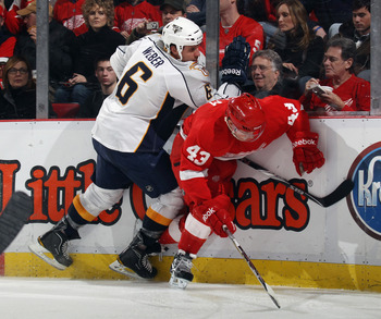 DETROIT, MI - DECEMBER 08: Shea Weber #6 of the Nashville Predators hits Darren Helm #43 of the Detroit Red Wings at the Joe Louis Arena on December 8, 2010 in Detroit, Michigan. The Predators defeated the Red Wings 3-2. (Photo by Bruce Bennett/Getty Imag
