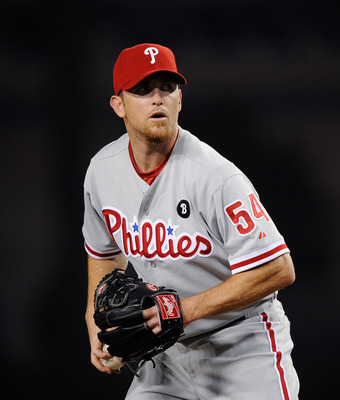 LOS ANGELES, CA - AUGUST 08:  Pitcher Brad Lidge #54 of the Philadelphia Phillies throws against the Los Angeles Dodgers at Dodger Stadium on August 8, 2011 in Los Angeles, California.  (Photo by Kevork Djansezian/Getty Images)
