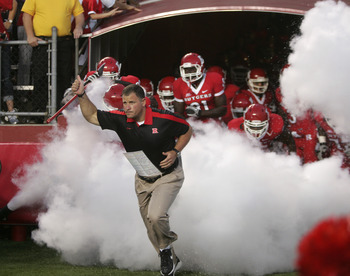 PISCATAWAY, NJ - SEPTEMBER 1: Greg Schiano Head Coach of Rutgers Scarlet Knights leads his team into the field before their college football game against North Carolina Central Eagles on September 1, 2011 at High Point Solutions Stadium in Piscataway, New
