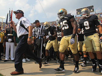 SOUTH BEND, IN - SEPTEMBER 03:  Head coach Brian Kelly of the Notre Dame Fighting Irish leads his team onto the field before taking on the University of South Florida Bulls at Notre Dame Stadium on September 3, 2011 in South Bend, Indiana. South Florida d