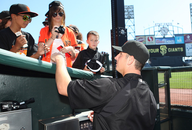 SAN FRANCISCO, CA - AUGUST 28: Eric Surkamp #47 of the San Francisco Giants signs autographs for fans before a game between the Houston Astros and San Francisco Giants at AT&T Park on August 28, 2011 in San Francisco, California.  (Photo by Tony Medina/Ge