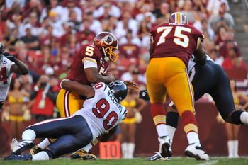 LANDOVER - SEPTEMBER 19:  Mario Williams #90 of the Houston Texans sacks Donovan McNabb #5 of the Washington Redskins at FedExField on September 19, 2010 in Landover, Maryland. The Texans defeated the Redskins 30-27 in overtime. (Photo by Larry French/Get