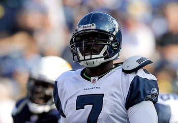 SAN DIEGO, CA - AUGUST 11:  Quarterback Tarvaris Jackson #7 of the Seattle Seahawks reacts after getting sacked in the second quarter against the San Diego Chargers during the NFL preseason game at Qualcomm Stadium on August 11, 2011 in San Diego, Califor