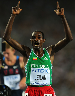 DAEGU, SOUTH KOREA - AUGUST 28:  Ibrahim Jeilan of Ethiopia celebrates after wiinning the men's 10,000 metres final during day two of the 13th IAAF World Athletics Championships at the Daegu Stadium on August 28, 2011 in Daegu, South Korea.  (Photo by Stu