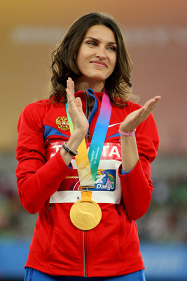 DAEGU, SOUTH KOREA - SEPTEMBER 04:  Anna Chicherova of Russia stands on the podium with her gold medal during the medal ceremony for the women's high jump during day nine of 13th IAAF World Athletics Championships at Daegu Stadium on September 4, 2011 in