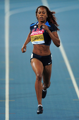 DAEGU, SOUTH KOREA - AUGUST 27:  Sanya Richards-Ross of United States competes in the women's 400 metres heats during day one of the 13th IAAF World Athletics Championships at the Daegu Stadium on August 27, 2011 in Daegu, South Korea.  (Photo by Stu Fors