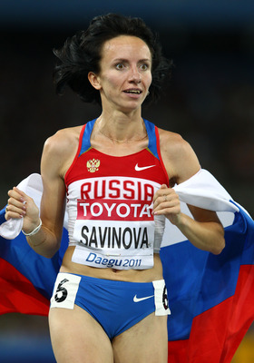 DAEGU, SOUTH KOREA - SEPTEMBER 04:  Mariya Savinova of Russia celebrates with her country's flag after claiming gold in the women's 800 metres final during day nine of the 13th IAAF World Athletics Championships at the Daegu Stadium on September 4, 2011 i