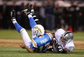 OAKLAND, CA - SEPTEMBER 14:  Richard Seymour #92 of the Oakland Raiders sacks Philip Rivers #17 of the San Diego Chargers on September 14, 2009 at the Oakland-Alameda County Coliseum in Oakland, California.  (Photo by Ezra Shaw/Getty Images)