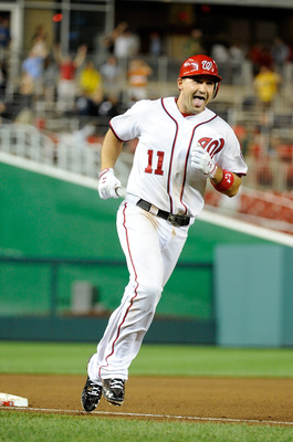 WASHINGTON, DC - AUGUST 19:  Ryan Zimmerman #11 of the Washington Nationals rounds third base after hitting a game-winning grand slam in the ninth inning against the Philadelphia Phillies at Nationals Park on August 19, 2011 in Washington, DC. The Nationa