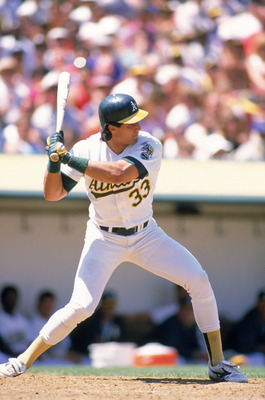 OAKLAND, CA -1988:  Jose Canseco #33 of the Oakland Athletics prepares to swing during his at bat in a 1988 MLB season game at Oakland-Alameda County Coliseum in Oakland, California.  (Photo by Otto Greule Jr/Getty Images)