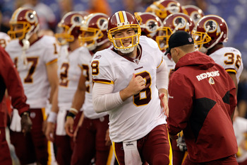 BALTIMORE, MD - AUGUST 25: Quarterback Rex Grossman #8 of the Washington Redskins warms up prior to the start of a preseason game against the Baltimore Ravens at M&T Bank Stadium on August 25, 2011 in Baltimore, Maryland.  (Photo by Rob Carr/Getty Images)