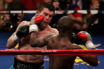 LAS VEGAS - DECEMBER 08:  (R-L) Floyd Mayweather Jr. throws a left to the head of Ricky Hatton of England during their WBC world welterweight championship fight at the MGM Grand Garden Arena on December 8, 2007 in Las Vegas, Nevada.  (Photo by John Gichig