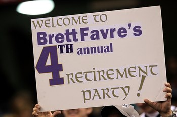 NEW ORLEANS - JANUARY 24:  A fan holds up a sign which reads 'Welcome to Brett Favre's 4th annual Retirement Party!' in reference to Brett Favre #4 of the Minnesota Vikings as he plays against the New Orleans Saints during the NFC Championship Game at the