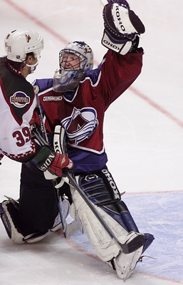 17 Apr 2000:  Goalie Patrick Roy #33 of the Colorado Avalanche makes a save as Travis Green #39 of the Phoenix Coyotes skates up to the crease in the third period during game three of the first round of Stanley Cup Playoffs at America West Arena in Phoeni