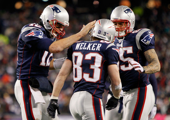 FOXBORO, MA - DECEMBER 06:  (L-R) Tom Brady #12, Wes Welker #83 and Aaron Hernandez #85 of the New England Patriots celebrate after Welker scored a touchdown in the third quarter against the New York Jets at Gillette Stadium on December 6, 2010 in Foxboro