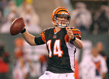 EAST RUTHERFORD, NJ - AUGUST 21:  Andy Dalton #14 of the Cincinnati Bengals looks to pass against the New York Jets during their pre season game on August 21, 2011 at the New Meadowlands Stadium in East Rutherford, New Jersey.  (Photo by Al Bello/Getty Im