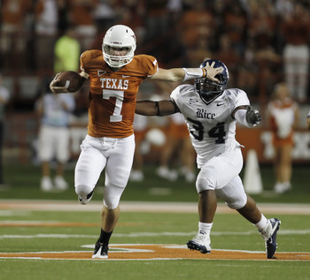AUSTIN, TX - SEPTEMBER 3:  Quaterback Garrett Gilbert #7 of the Texas Longhorns runs past linebacker Cameron Nwosu #34 of the Rice Owls in the second quarter on September 3, 2011 at Darrell K. Royal-Texas Memorial Stadium in Austin, Texas.  (Photo by Eric