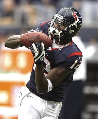 HOUSTON - DECEMBER 13:  Wide receiver Jacoby Jones #12 of the Houston Texans catches during pre-game warmups before the game against the Seattle Seahawks at Reliant Stadium on December 13, 2009 in Houston, Texas.  (Photo by Bob Levey/Getty Images)