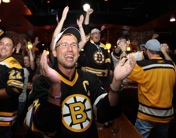 BOSTON, MA - JUNE 15:  Fans of the Boston Bruins react to a goal at Hurricane O'Reilly's Bar during Game Seven of the 2011 Stanley Cup Final against the Vancouver Canucks on June 15, 2011 in Boston, Massachusetts. (Photo by Jim Rogash/Getty Images)