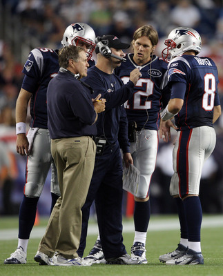 FOXBORO, MA - AUGUST 11:  Head coach Bill Belichick of the New England Patriots along with Bill O'Brien and Tom Brady #12, talk with Brian Hoyer #8 in the first half against the Jacksonville Jaguars on August 11, 2011 at Gillette Stadium in Foxboro, Massa