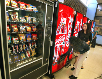 CHICAGO - APRIL 20:  Students purchase soft drinks from vending machines at Jones College Prep High School April 20, 2004 in Chicago, Illinois. The Chicago Public School system will introduce next fall a new vending policy restricting junk food and a new