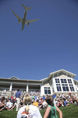 SNOQUALMIE, WA - AUGUST 26:  A Boeing 787 Dreamliner flies over the TPC Snoqualmie Ridge golf course as part of the opening ceremonies prior to the first round of the Boeing Classic at TPC Snoqualmie Ridge, on August 26, 2011 in Snoqualmie, Washington. (P
