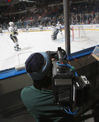 UNIONDALE, NY - DECEMBER 29: A videographer for HBO's 24/7 series shoots warm ups prior to the game between the New York Islanders and the Pittsburgh Penguins at the Nassau Coliseum on December 29, 2010 in Uniondale, New York. (Photo by Bruce Bennett/Gett