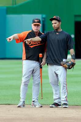 WASHINGTON, DC - JUNE 17:  (L-R) Manager Buck Showalter of the Baltimore Orioles talks with Robert Andino #11 before the game against the Washington Nationals at Nationals Park on June 17, 2011 in Washington, DC.  (Photo by Greg Fiume/Getty Images)