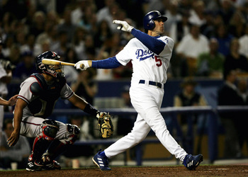 LOS ANGELES - AUGUST 19:  Shawn Green #15 of the Los Angeles Dodgers hits his second home run of the game and the second of back to back home runs with Adrian Beltre to tie the score at 5-5 with the Atlanta Braves in the eighth inning on August 19, 2004 a