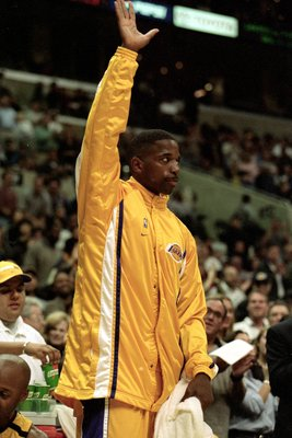 26 Nov 1999:  A. C. Green of the Los Angeles Lakers waves to the crowd during a game against the New Jersey Nets  at the Staples Center in Los Angeles, California. The Lakers defeated the Nets 103-80.   Mandatory Credit: Donald Miralle  /Allsport