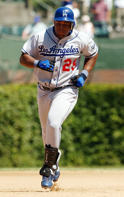 CHICAGO - AUGUST 15: Adrian Beltre #29 of the Los Angeles Dodgers rounds the bases after hitting a home run in the fourth inning against the Chicago Cubs during a game on August 15, 2004 at Wrigley Field in Chicago, Illinois. The Dodgers defeated the Cubs