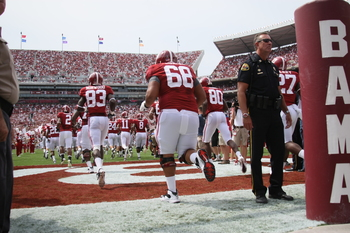 TUSCALOOSA, AL - SEPTEMBER 3:  The Alabama Crimson Tide takes the field for their first game since the devastating April 27th tornadoes with the Kent State Golden Flashes on September 3, 2011 at Bryant Denny Stadium in Tuscaloosa, Alabama.  Alabama defeat