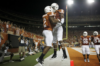 AUSTIN, TX - SEPTEMBER 3:  Running back Fozzy Whittaker #2 and wide receiver John Harris #9 of the Texas Longhorns celebrate a fourth quarter touchdown against the Rice Owls on September 3, 2011 at Darrell K. Royal-Texas Memorial Stadium in Austin, Texas.
