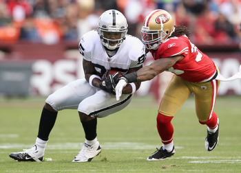 SAN FRANCISCO, CA - AUGUST 20:  Darrius Heyward-Bey #85 of the Oakland Raiders catches a ball while covered by Dashon Goldson #38 of the San Francisco 49ers at Candlestick Park on August 20, 2011 in San Francisco, California.  (Photo by Ezra Shaw/Getty Im