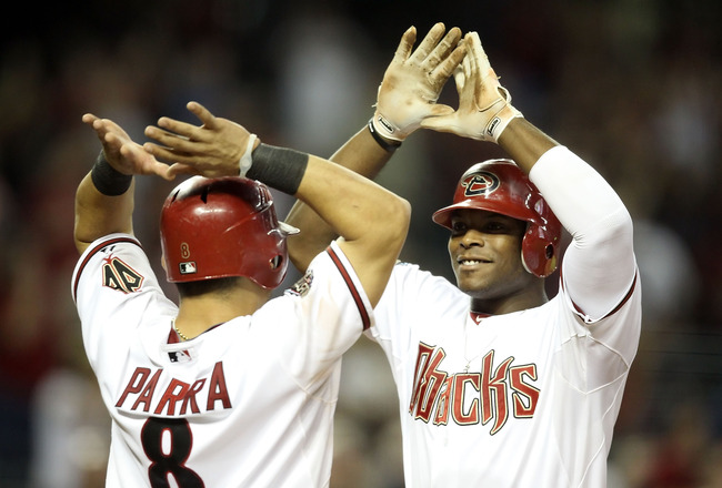 PHOENIX, AZ - AUGUST 30:  Justin Upton #10 of the Arizona Diamondbacks high fives Gerardo Parra #8 after Upton hit a two run home against the Colorado Rockies during the eighth inning of the Major League Baseball game at Chase Field on August 30, 2011 in