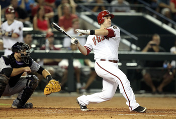 PHOENIX, AZ - AUGUST 30:  Miguel Montero #26 of the Arizona Diamondbacks hits a three run home run against the Colorado Rockies during the fifth inning of the Major League Baseball game at Chase Field on August 30, 2011 in Phoenix, Arizona.  (Photo by Chr