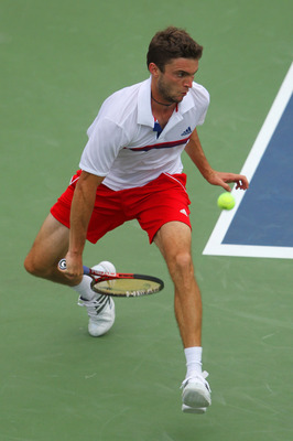 NEW YORK, NY - SEPTEMBER 04:  Gilles Simon of France returns a shot through his legs against Juan Martin Del Potro of Argentina during Day Seven of the 2011 US Open at the USTA Billie Jean King National Tennis Center on September 4, 2011 in the Flushing n
