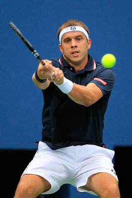 NEW YORK, NY - SEPTEMBER 07:  Gilles Muller of Luxembourg returns a shot against Rafael Nadal of Spain during Day Ten of the 2011 US Open at the USTA Billie Jean King National Tennis Center on September 7, 2011 in the Flushing neighborhood of the Queens b